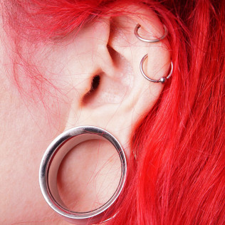body piercing - multiple ear piercings
